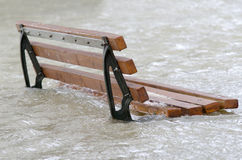 Deluge. A bench surrounded by water Royalty Free Stock Photo