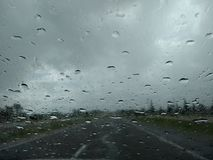 Deluge on the route. Rain on the car windshield Stock Photo