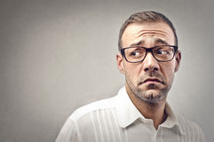 Delusion. Portrait of sad young man Royalty Free Stock Image
