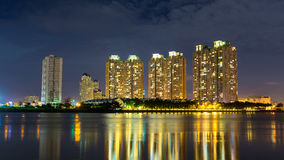 Deluxe apartment under night viewed from Thu Thiem peninsula in Ho chi minh city, Vietnam, on Sai Gon river. Stock Image