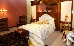 Deluxe bedroom. Wide luxury bedroom interior with classic wood furniture Stock Image