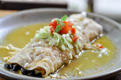 Deluxe Burrito or smothered burrito. Mexican food royalty free stock image