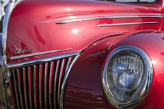 Deluxe Classic Car. Red classic deluxe car on display Stock Image