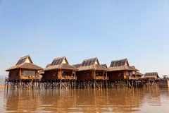 Deluxe hotel on Inle Lake, Myanmar. Deluxe hotel situated on the waters of InleLake with captivating view of the beautiful Inle Lake where water and mountains stock image