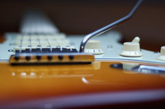Deluxe knobs. Close-up of a Fender American Deluxe guitar knobs and bridge stock photos