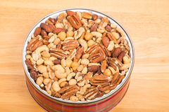 Deluxe Mixed Nuts in Red Tin Royalty Free Stock Photo