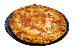 Deluxe Pizza. Hot deluxe pizza right out of the oven on a black tray and ready to eat royalty free stock photography
