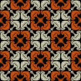 Deluxe seamless pattern with decorative ornament of white and orange shades on black background Royalty Free Stock Photo
