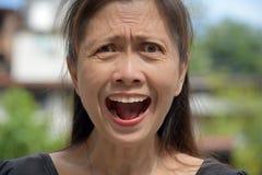 Demência e Filipina Granny imagens de stock royalty free