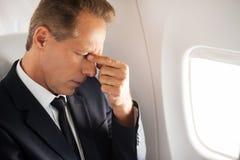 Dem glauben schreckliche Kopfschmerzen Lizenzfreies Stockfoto