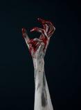 Demônio ensanguentado do zombi da mão Foto de Stock