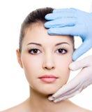 Demande de règlement de beauté de visage de femme Photographie stock