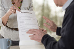 Demanding divorce. Elderly women demanding divorce form her husband Stock Photo