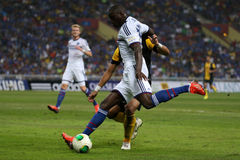 Demba Ba. SHAH ALAM - JULY 21: Chelsea Football Club player Demba Ba (white jersey) attempts a shot at goal in a friendly match with the Malaysian national team Stock Image