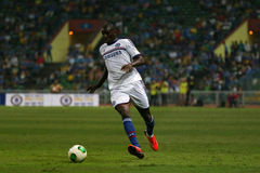 Demba Ba. SHAH ALAM - JULY 21: Chelsea Football Club player Demba Ba (white jersey) controls the ball in a friendly match with the Malaysian national team in Stock Photo