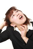 Demented businesswoman Royalty Free Stock Photo