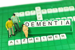 Dementia. Or Alzheimer support abstract concept with keywords and miniature people stock image