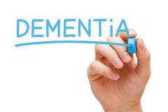 Dementia Blue Marker. Hand writing Dementia with blue marker on transparent wipe board Royalty Free Stock Photography