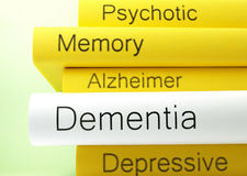 Dementia. A horizontal stack of dementia-related book titles royalty free stock image