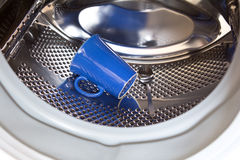 Dementia mug spoon washing machine Royalty Free Stock Images