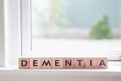 Dementia sign in a window. In a bright room royalty free stock image