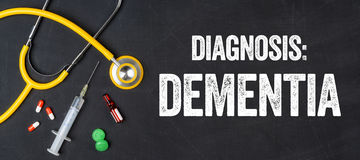 Dementia. Stethoscope and pharmaceuticals on a blackboard - Dementia royalty free stock images