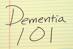 Demenza 101 su un blocco note giallo Fotografia Stock Libera da Diritti