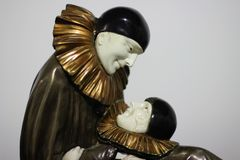 Demetre Chiparus. The eternal story. Stone, bronze, ivory. Two, man and woman clowns, loving glances. Famous sculpture. The museum, Kiev Royalty Free Stock Image