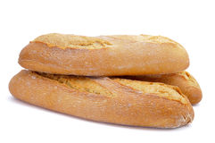 Demi baguettes. Some demi baguettes or bread rolls on a white background royalty free stock photography