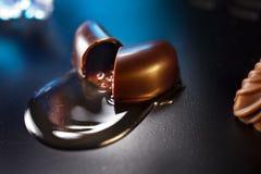 Demi chocolat avec de l'alcool Photographie stock libre de droits