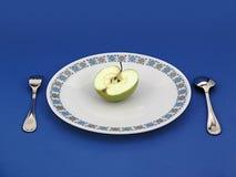 Demi d'Apple pour le wagon-restaurant Images libres de droits