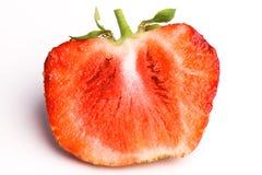 Demi fraises sur un fond blanc Images stock
