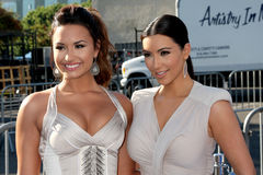 Demi Lovato, Kim Kardashian Stock Photo