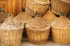Demijohn Wine Bottles. Enclosed in wickerwork outside a restaurant in Florence, Italy Stock Photos