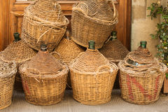 Demijohn Wine Bottles. Enclosed in wickerwork outside a restaurant in Florence, Italy Royalty Free Stock Photo