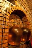 Demijohn in wine cave. Wine demijohn in the wine cave Royalty Free Stock Image