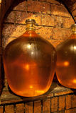 Demijohn in wine cave Stock Image