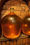 Demijohn in wine cave. Wine demijohn in the wine cave Stock Image