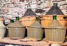 Demijohns of wine. Stock Image