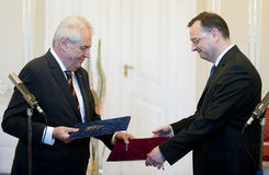 Demission of Czech premier Petr Necas. Czech Prime Minister Petr Necas (right) tendered his resignation to President Milos Zeman (left), who accepted it and Stock Images