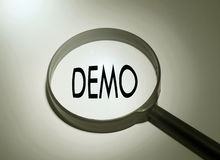 Demo. Magnifying glass with the word demo. Searching demo Royalty Free Stock Photo