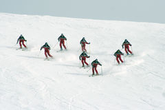 Demo team. Skiing team is demonstrating the carving technique Stock Photography