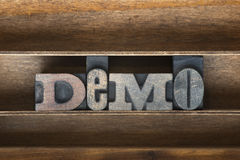 Demo wooden tray. Demo word made from vintage letterpress type on wooden tray Stock Photo