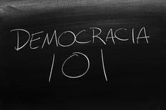 Democracia 101 On A Blackboard. Translation: Democracy 101. The words Democracia 101 on a blackboard in chalk. Translation: Democracy 101 stock photos