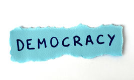 A democracia da palavra no papel azul Imagens de Stock Royalty Free