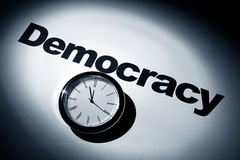 Democracy. Clock and word of Democracy for background royalty free stock image