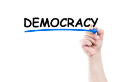 Democracy. Concept text write on transparent wipe board by hand holding a marker royalty free stock photos