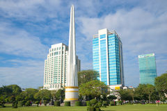 Democracy Monument against the backdrop of modern high-rise buildings. Yangon, Myanmar Royalty Free Stock Photos
