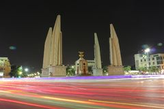 Democracy monument is circular traffic landmark at Bangkok Thailand . architecture in history . slow motion of light on street at stock photography