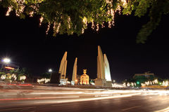 Democracy monument with light trails in Bangkok Royalty Free Stock Image